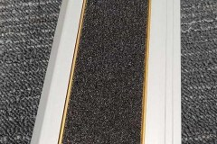 415-stair-nosing-with-wide-98-mm-tread-with-black-carborundum-with-gold-trim